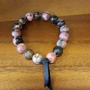 Approximately 7.5 inch, 8 mm Rhonodite bracelet